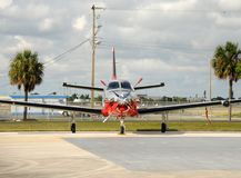 Turboprop airplane. Front view of modern turboprop airplane on the ground Stock Photography