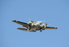 Turboprop airplane. Twin engine turboprop airplane approaching for landing Stock Photography
