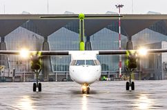 Turboprop airplane aircraft with the included engines on taxi at the airport. Turboprop airplane aircraft with the included engines on taxi at the airport Stock Image
