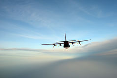 Turboprop airplane in flight Royalty Free Stock Photos