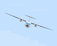 Turboprop airplane in flight Royalty Free Stock Photo