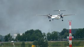 Turboprop airplane landing. AMSTERDAM, THE NETHERLANDS - JULY 27, 2017: FlyBe Bombardier Dash 8 Q400 G-JECO landing. Shiphol Airport, Amsterdam, Holland stock video footage