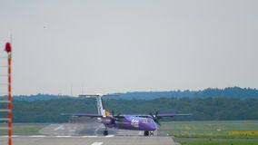 Turboprop airplane taxiing after landing. DUSSELDORF, GERMANY - JULY 22, 2017: FlyBe Bombardier Dash 8 Q400 G-PRPE taxiing after landing. Dusseldorf Airport stock footage