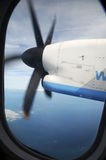 Turboprop in flight. View of the starboard PW123C engine from seat 10D on a FlyBe Bombardier Dash-8 200 aircraft, high over the English Channel Royalty Free Stock Image