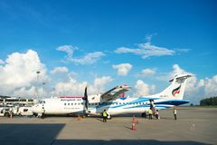 Turboprop passenger aircraft of Bangkok Airways in Phuket airpor. PHUKET, THAILAND - 24 APR 17: Turboprop passenger airplane of Bangkok Airways in Phuket Royalty Free Stock Photos