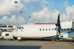 Turboprop aircraft with propellers in an airport. Turboprop passenger airplane with propellers in an airport Royalty Free Stock Photography