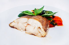 Turbot braised with vegetables Royalty Free Stock Image