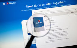 Turbotax web page. MONTREAL, CANADA - FEBRUARY 12, 2017 - Turbotax page under magnifying glass. Turbotax is an application for accurate tax calculations stock photography
