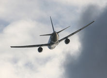 Turbulence Ahead. Airplane flying into stormy weather Royalty Free Stock Photos