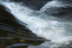 Turbulence in rapids of the Sugar River in Newport, New Hampshire. Small rapids in the Sugar River, Newport, New Hampshire, with drop and silky, splashing Stock Photos