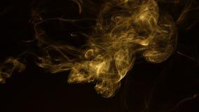 Turbulence yellow smoke on a black background.
