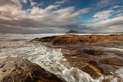 Turbulent Flow. The beach of Moledo do Minho in Portugal with Santa Tegra mountain in the background Royalty Free Stock Image