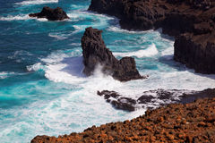 Turbulent ocean waves crashing into rocky shoreline of Sao Nicolau island, Cape Verde Stock Photo