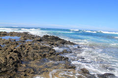 Turbulent ocean waves with white foam beat coastal stones, Fuert Royalty Free Stock Photos