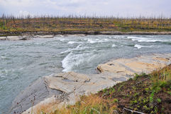 Turbulent rapids on a Northern river. Stock Images