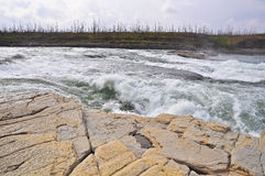 Turbulent rapids on a Northern river. Royalty Free Stock Image