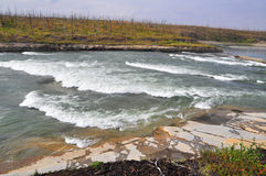 Turbulent rapids on the river. Stock Images