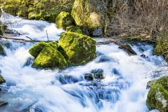 Turbulent river with long exposure Stock Photo