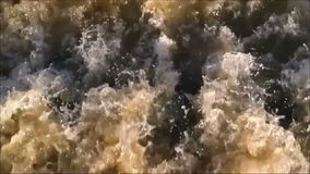 Turbulent rough water. Very turbulent rough flowing water with white crests and spray stock footage
