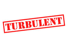 TURBULENT Rubber Stamp. Over a white background Stock Photos