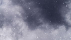 Turbulent snowfall from dark gray clouds stock video