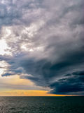 Turbulent stormy sky. An approaching storm creates a turbulent sky above the sea, near the harbor of Trieste Royalty Free Stock Images