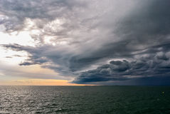 Turbulent stormy sky. An approaching storm creates a turbulent sky above the sea, near the harbor of Trieste Stock Photos