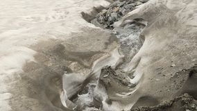 Turbulent stream running between white rocks, mountains. Stock footage stock footage