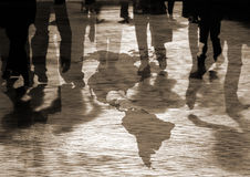 Turbulent times. Conceptual image of shoppers walking over american map Royalty Free Stock Photo