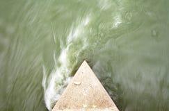 Turbulent water. Turbulent green water around bridge piling Royalty Free Stock Photography
