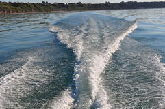 Turbulent water behind a speeding boat Royalty Free Stock Image