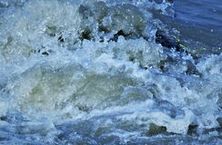 Turbulent water causing froth stock image