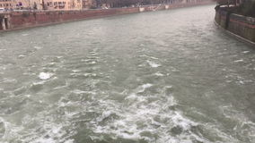 Turbulent water. Of the river Adige, flowing under Ponte Pietra, Verona Italy, in slow motion stock video