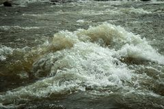 Turbulent water in river. Swollen due to snow melting stock photos