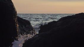 Turbulent water on a rocky coastline stock video