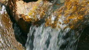 Turbulent water of stream or river. Closeup top view stock video footage