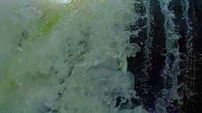 Turbulent waterfall, low angle. Submerging, accident, slowmotion. Stock footage stock video footage