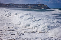 Turbulent waves during a storm. Turbulent waves crashing ashore during a storm at Bondi Beach in Sydney, Australia Royalty Free Stock Photography