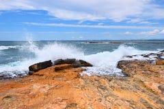 Turbulent wavy sea hitting the coast Royalty Free Stock Photos