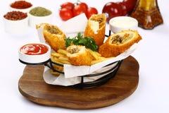 Turco Pacanga Boregi e patate fritte miste Fotografia Stock