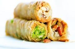 Turecki deser - Baklava z arachidem, pistachious, miód na białym tle zdrowi cukierki kosmos kopii fotografia stock