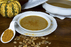 Tureen and Bowl of Curried Pumpkin Soup Royalty Free Stock Photography