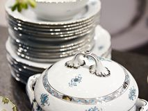 Tureen and stack of plates. Tureen and a stack of plates Stock Image