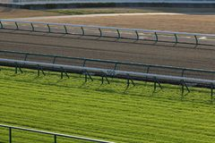 Turf and Dirt Horse Racing Track. Empty turf and dirt horse racing track Stock Photos