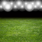 Turf of football stadium under the bright focuses Royalty Free Stock Photography
