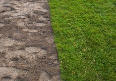 Turf placing. Green Turf placing brown ground Stock Image