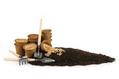 Turfpotten met zaden Stock Afbeelding