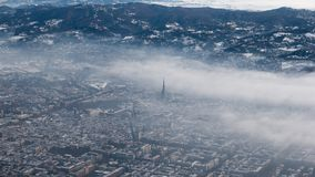 Turin aerial view. Torino cityscape from above, Italy. Winter, fog and clouds on the skylline. Smog and air pollution. Stock Image