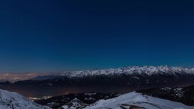 Turin city lights, panoramic night view from snow covered Alps by moonlight with clear sky. Italy. Turin city lights, panoramic night view from snow covered stock video