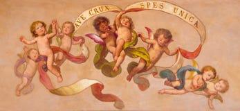 TURIN, ITÁLIA - 13 DE MARÇO DE 2017: O fresco barroco neo dos anjos com a inscrição na igreja Chiesa di San Giuseppe Imagem de Stock Royalty Free